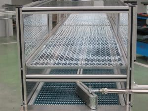Modular plastic belt conveyor with pneumatic dispenser