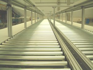 Roller conveyor assembly line and also a material handling system on a wide variety of conveyor belts