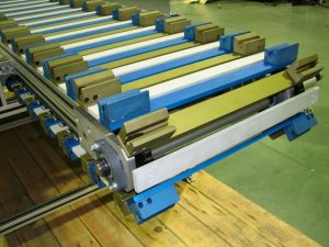 Timing belt conveyor with tooling